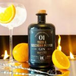 The gin To My Tonic Yuzu & Szechuan Pepper Gin Bottle with G&T glass and garnish infront of fireplace