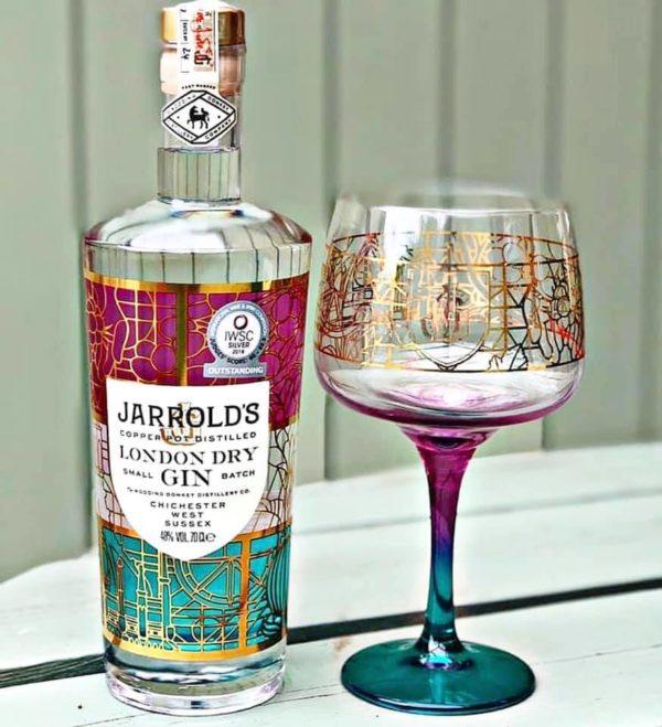 Jarrolds Gin and copa glass set shot outside
