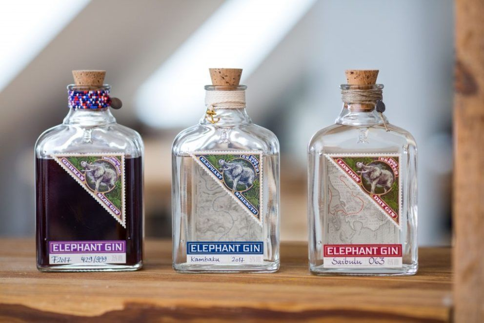 The Gin To My Tonic Elephant Bundle, featuring 3 bottles of Elephant Gin on a wooden beam